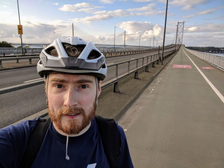 Me cycling across the deserted Forth Road Bridge