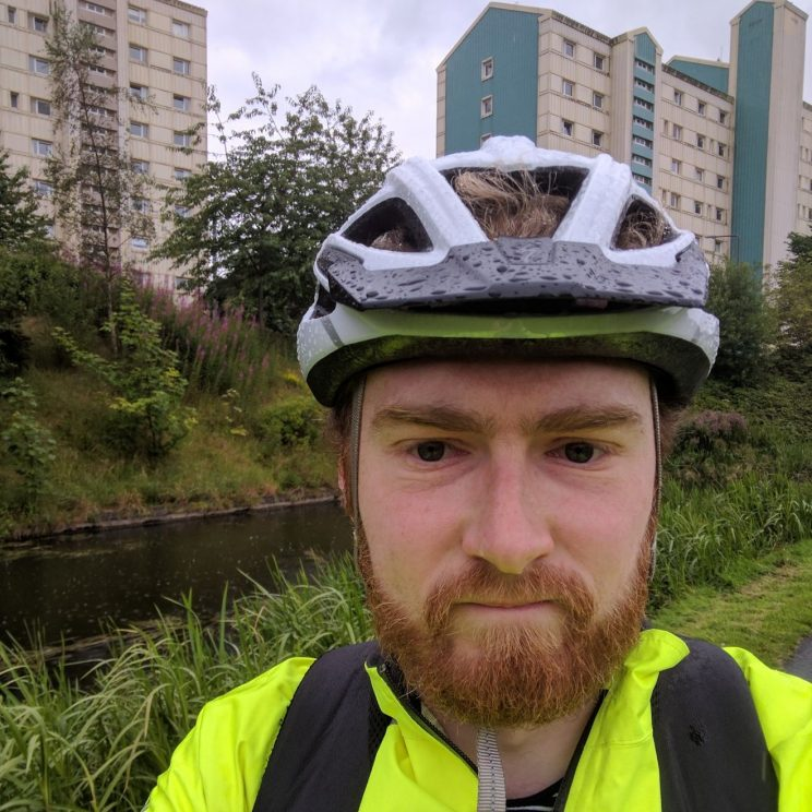 Me cycling in the rain at the canal