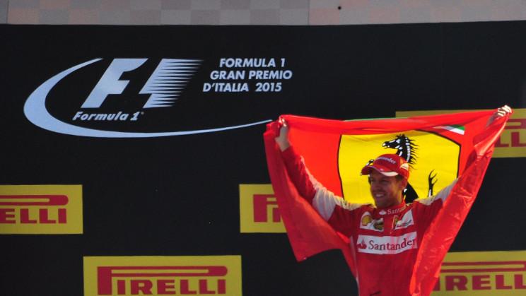 Sebastian Vettel on an F1 podium with the Futura typeface
