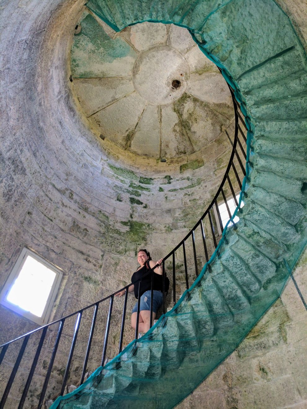 Alex climbing down the spiral staircase in Old Light