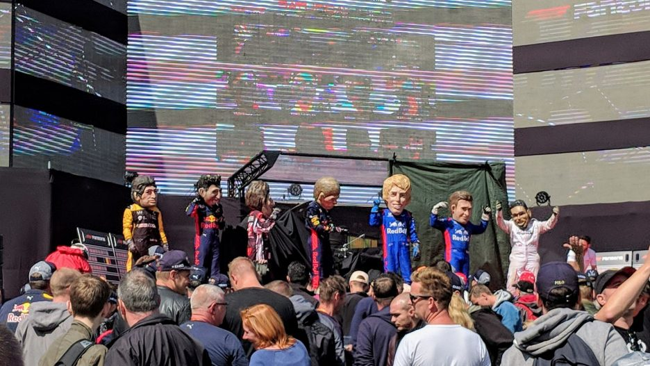 Bobbleheads on stage in the fanzone