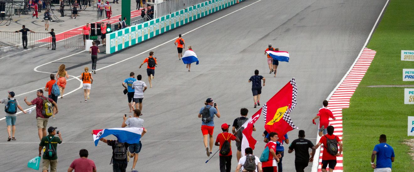 F1 fans running onto a circuit