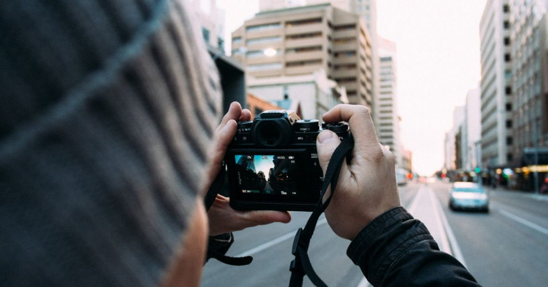 Photographer in a city