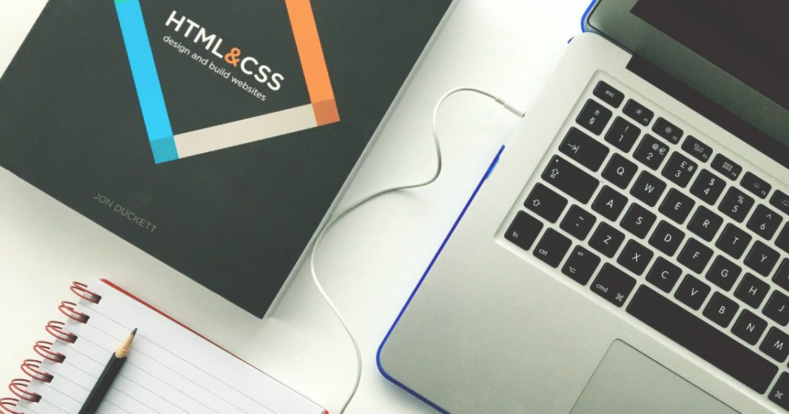Laptop, notebook and HTML & CSS book