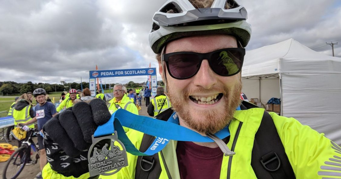 Me holding my medal after completing Pedal for Scotland 2018