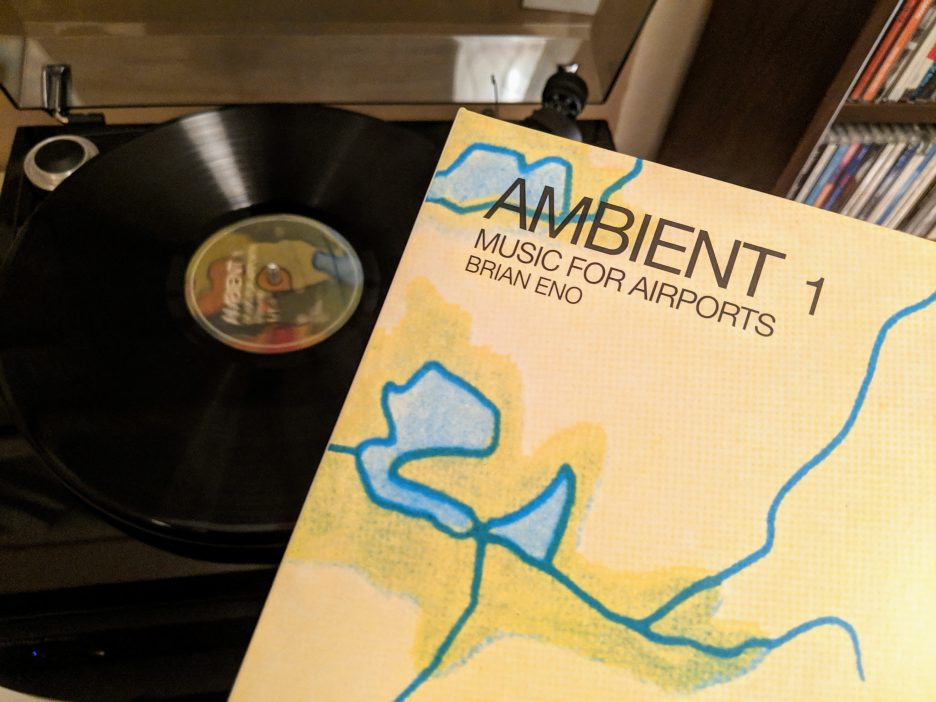 Ambient 1 / Music for Airports playing on my record player, with the record sleeve in front of it