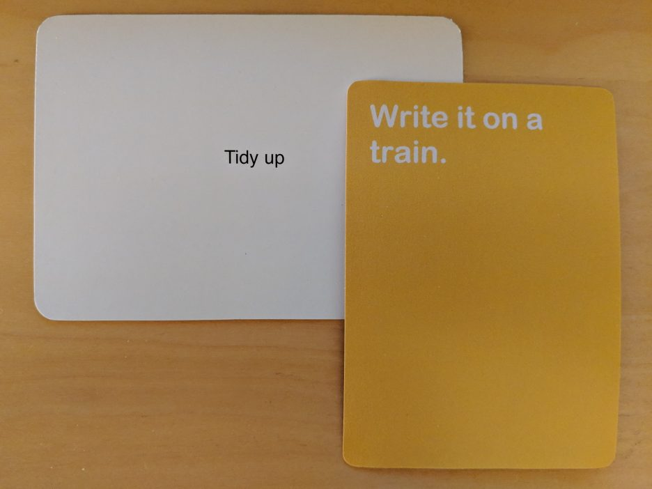 "Oblique Strategy card: ""Tidy up""; Blockbox card: ""Write it on a train."""