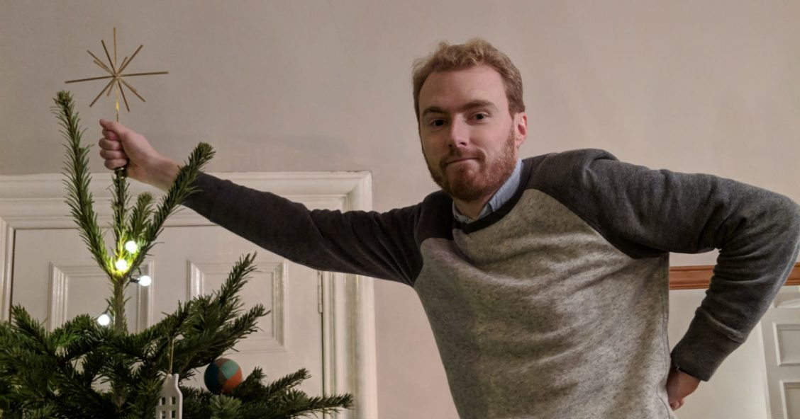 Me putting the star on the Christmas tree
