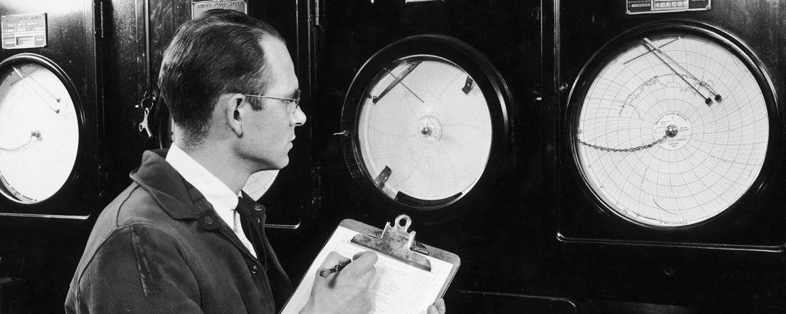 A man checking dials
