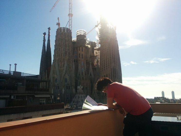 Jamie planning on our apartment balcony with Sagrada Família in view