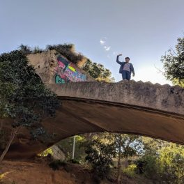 Jamie climbing a derelict bridge