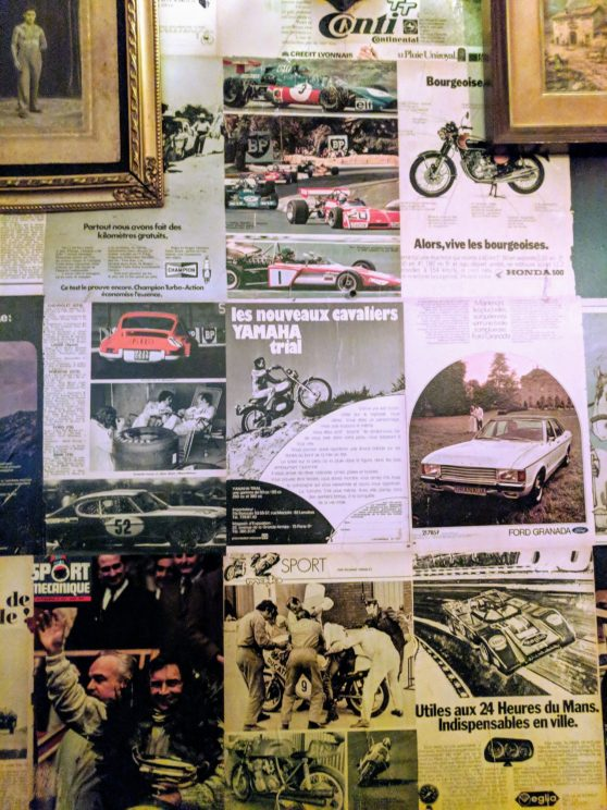 Motoring magazines used as wallpaper in a bar