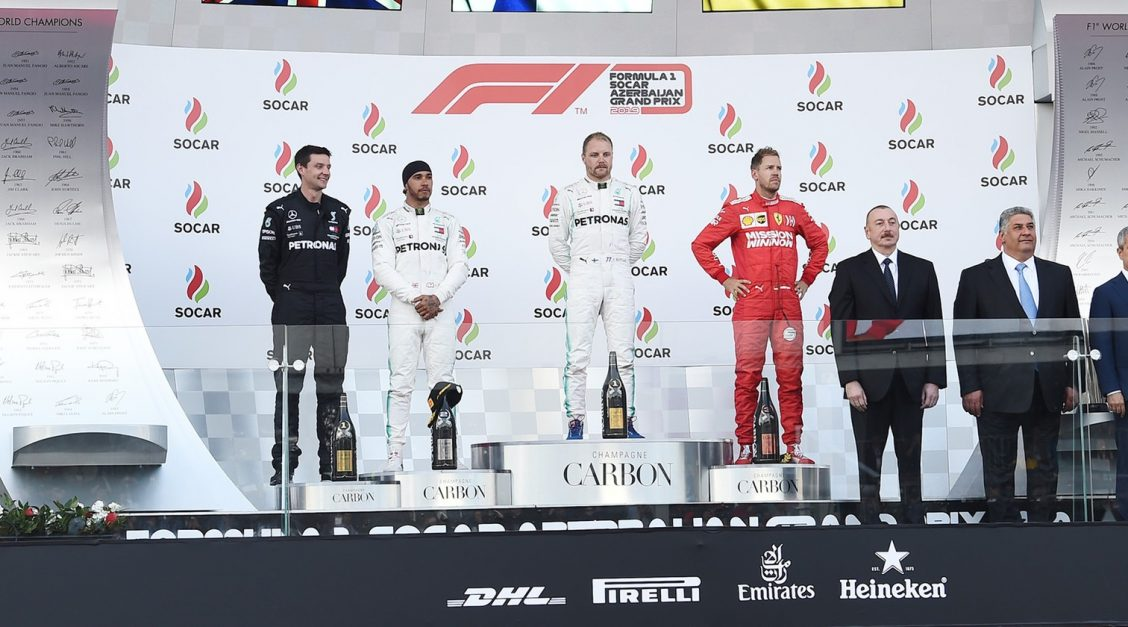 Lewis Hamilton and Valtteri Bottas on the Azerbaijan Grand Prix podium (image by President.az)