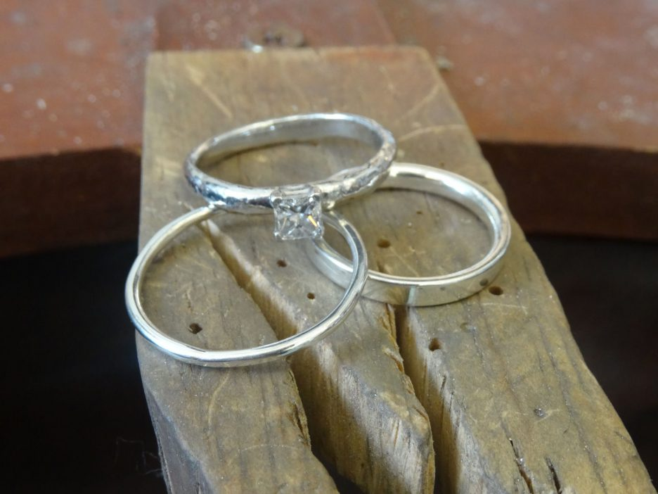 The finished wedding rings and Alex's engagement ring