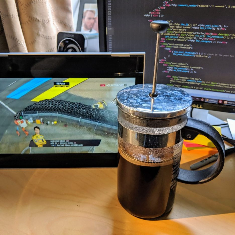 Big cafetiere next to a screen showing the 24 Hours of Le Mans
