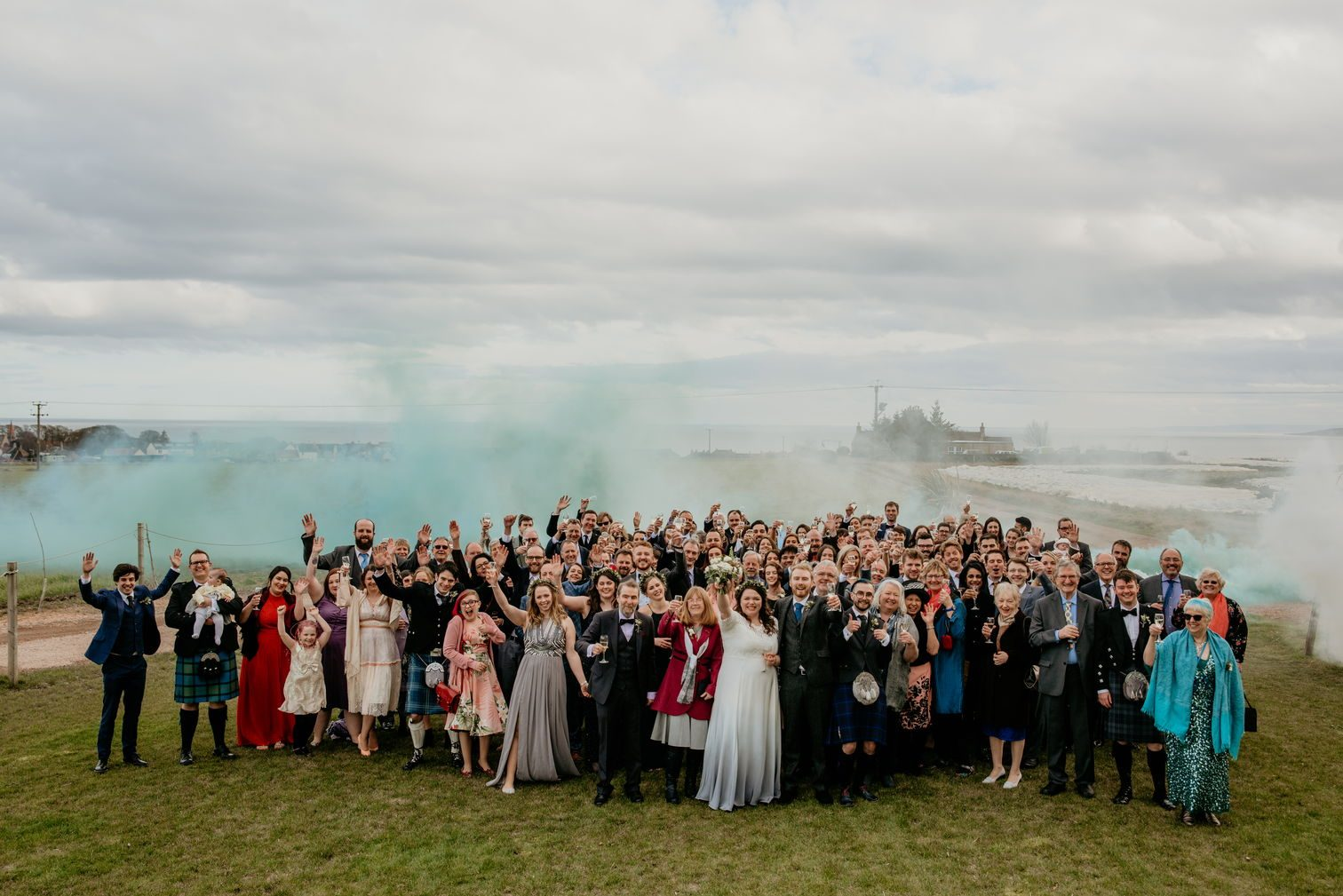 Group photo with smoke in the background