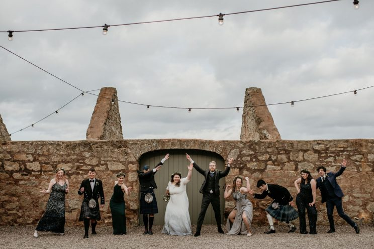 Bridesmaids and groomsmen pulling silly moves