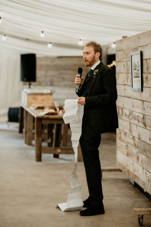 Me delivering my speech, with a long scroll of paper