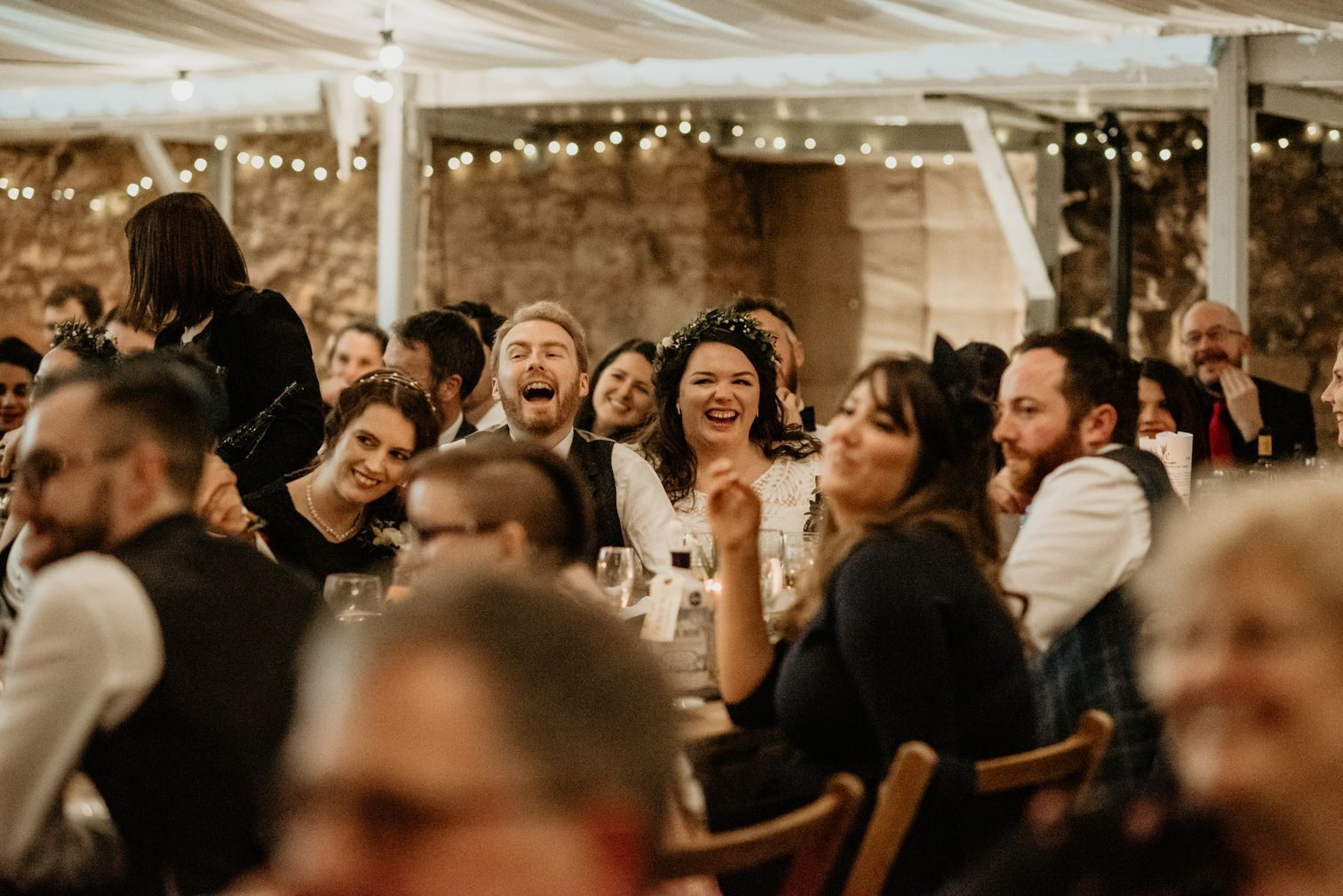 Me, Alex and guests laughing during a speech