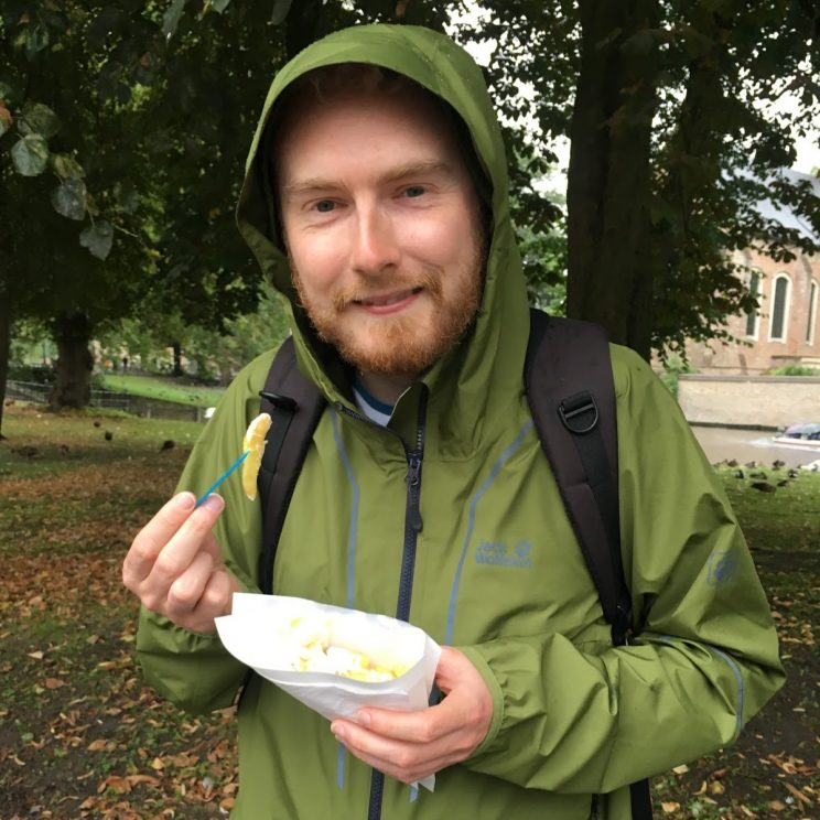 Me eating chips and mayo with my hood up in Bruges