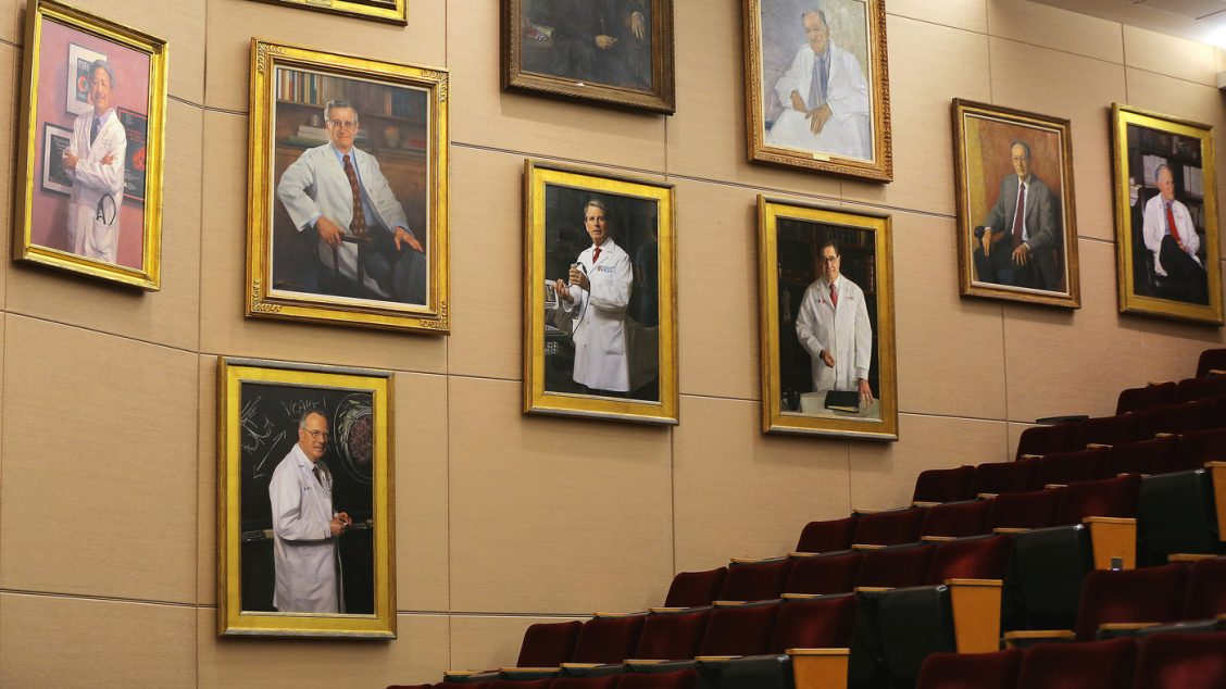 A 'dude wall' featuring several portraits of white old men