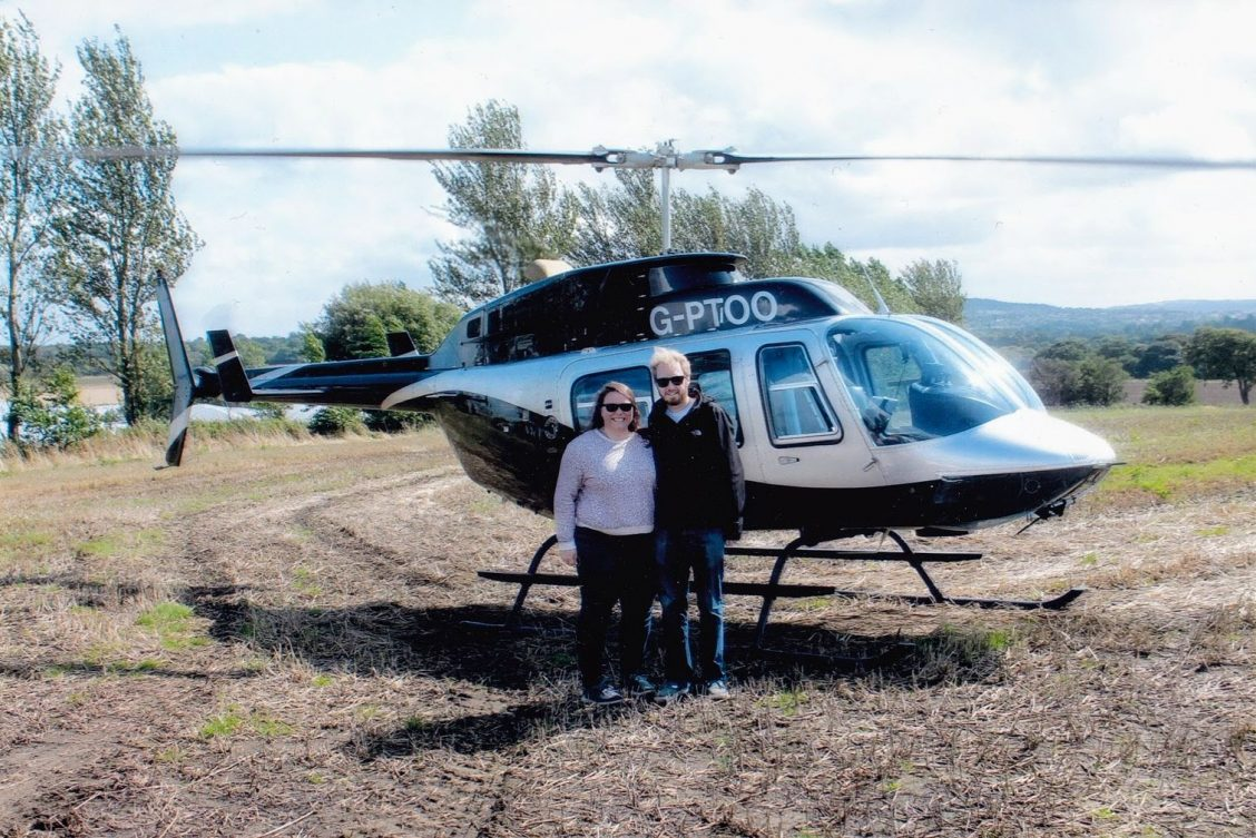 Alex and me standing at the helicopter before the flight