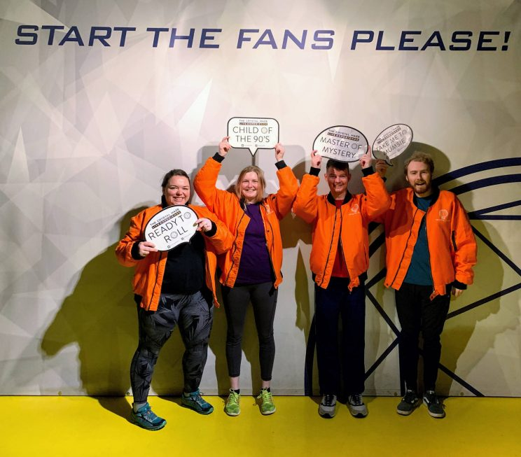 "Alex, Lucy, Richard and me posing with signs under the slogan ""Start the fans please!"""