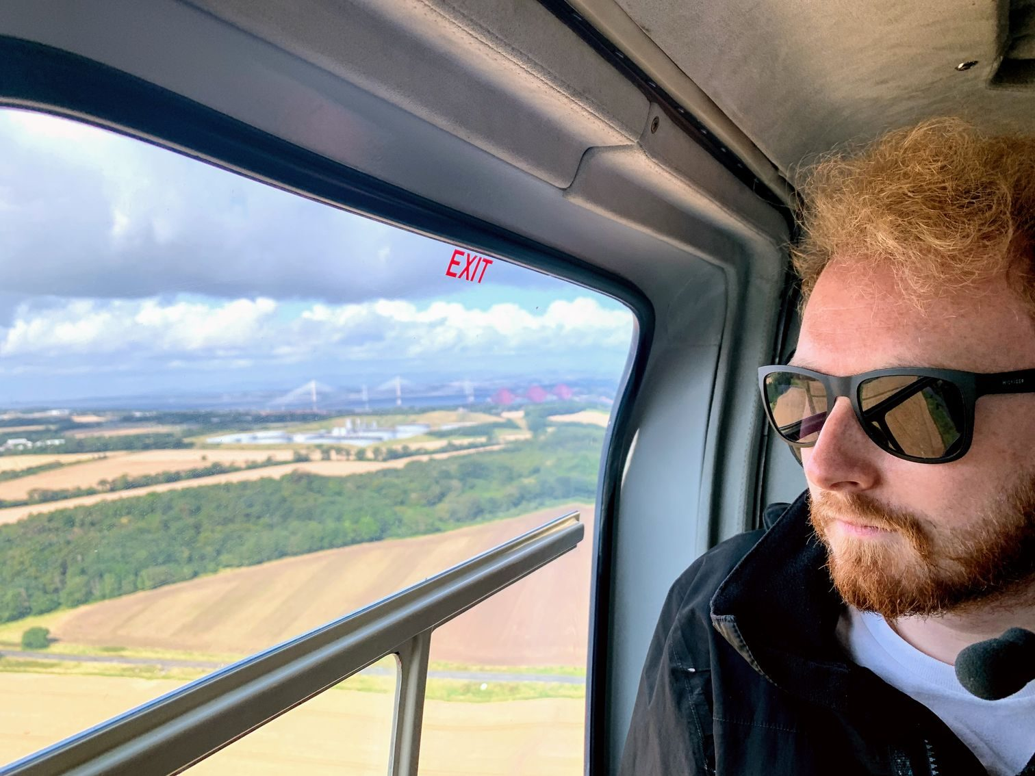 Me looking out the helicopter with the Forth bridges in the background