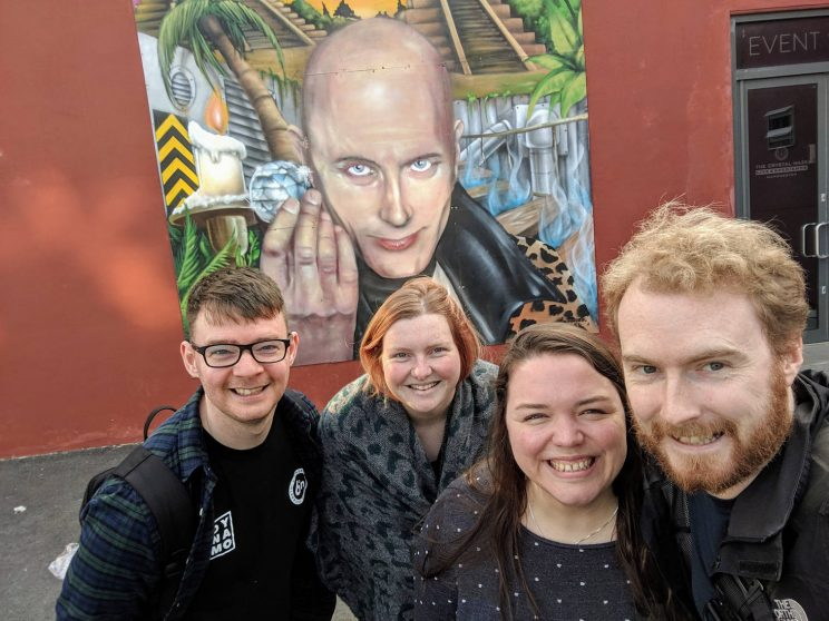 Richard, Lucy, Alex and me posing with a mural of Richard O'Brien