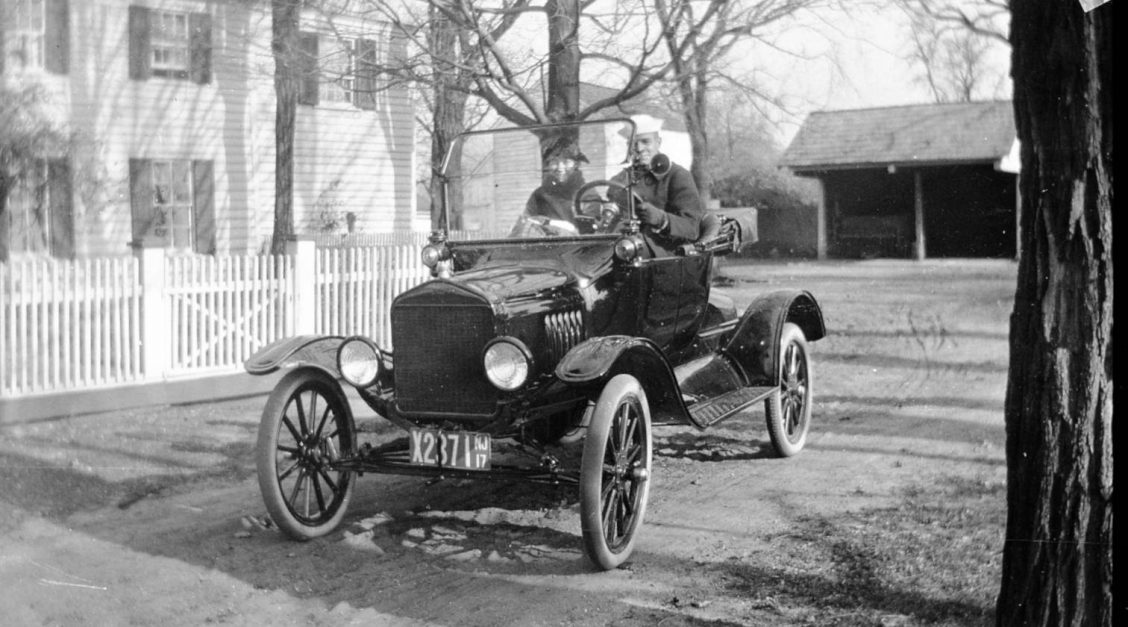 People driving a Ford Model T