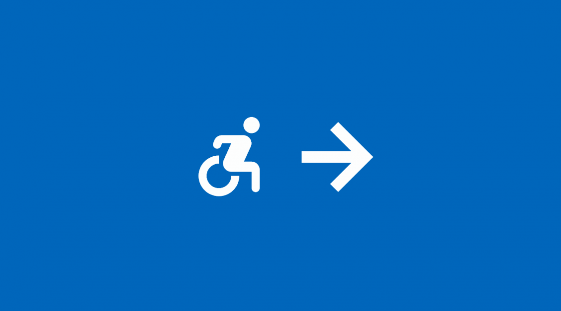 Accessibility icon (depicting a person in a wheelchair) with an arrow depicting forward movement