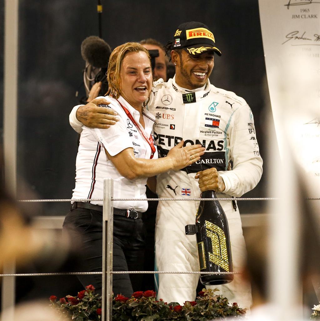 Britta Seeger and Lewis Hamilton on the podium at Abu Dhabi