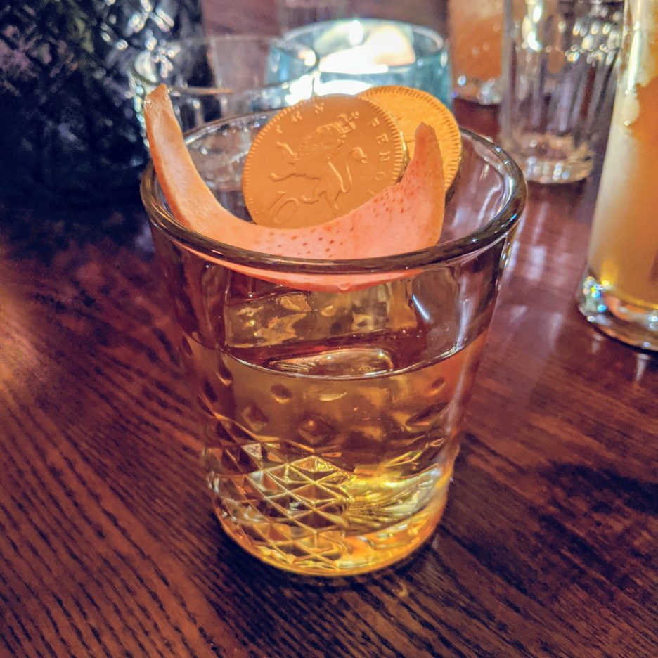 Old fashioned-style cocktail with chocolate coins in it