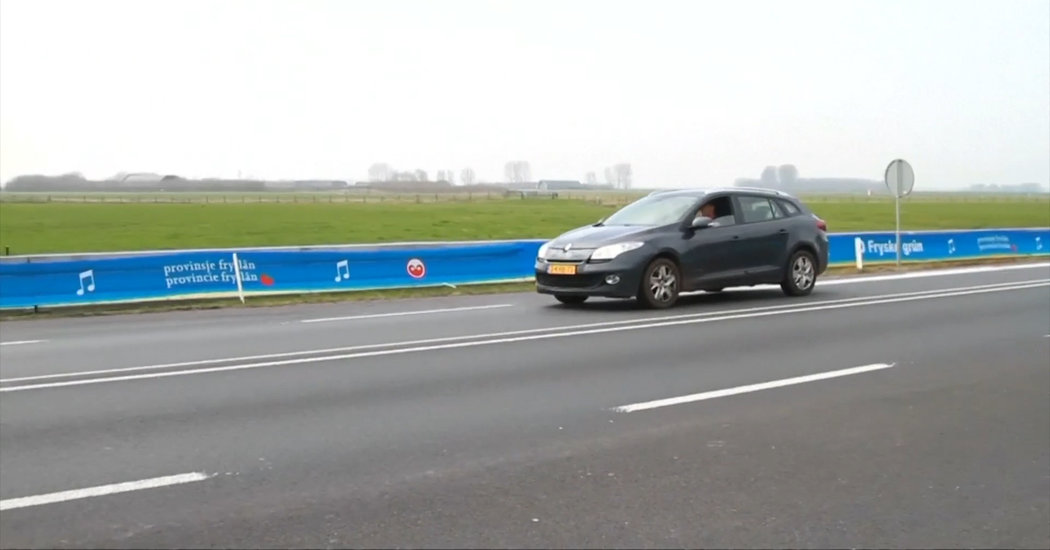 A car driving over the musical rumble strips