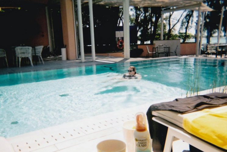 Alex floating in the pool (taken on the disposable camera)