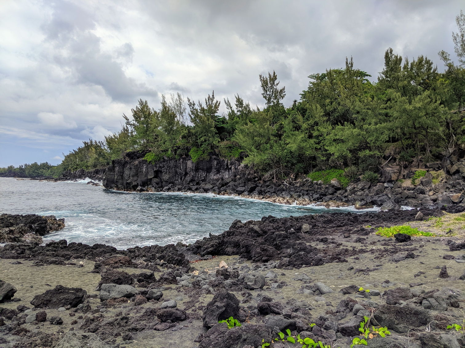 Black beach formed by the lava flow of 1977