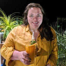 Alex with her cocktail at night