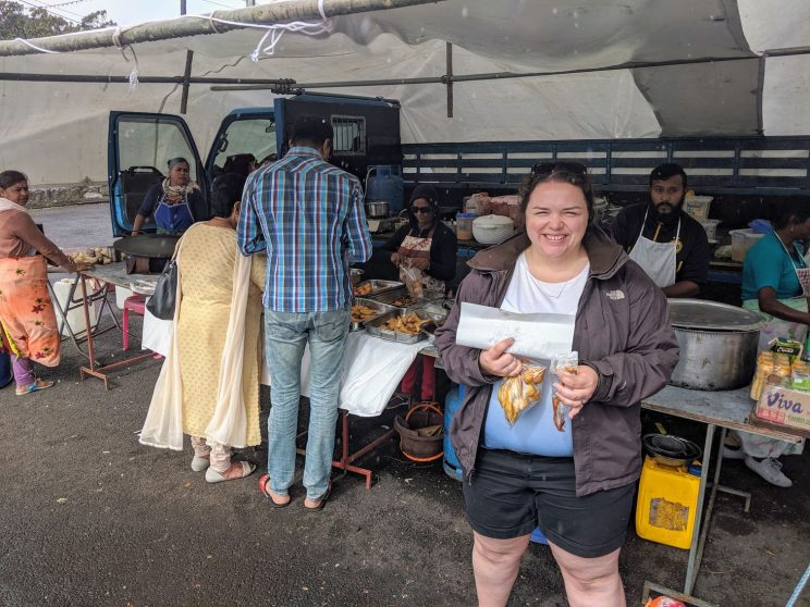 Alex in front of the food stall
