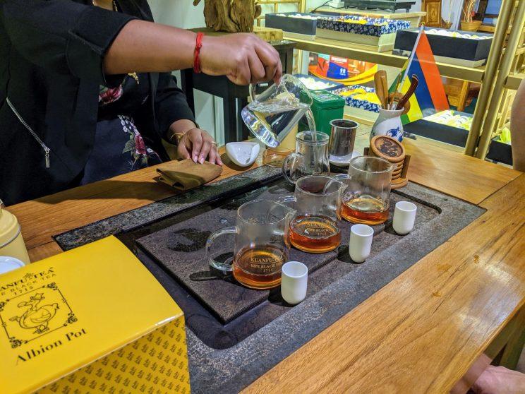 Caffiene-free kuafnu-tea being demonstrated to us