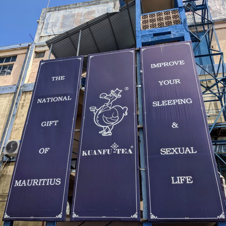 "Sign outside the tea factory: ""The national gift of Mauritius - Improve your sleeping & sexual life"""