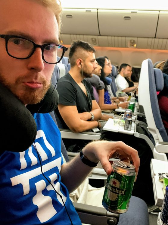 Me looking sad on the plane with a can of Heineken