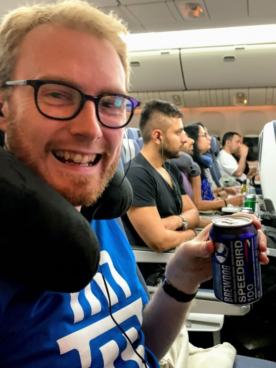 Me looking happy on the plane with a can of Brewdog Speedbird 100