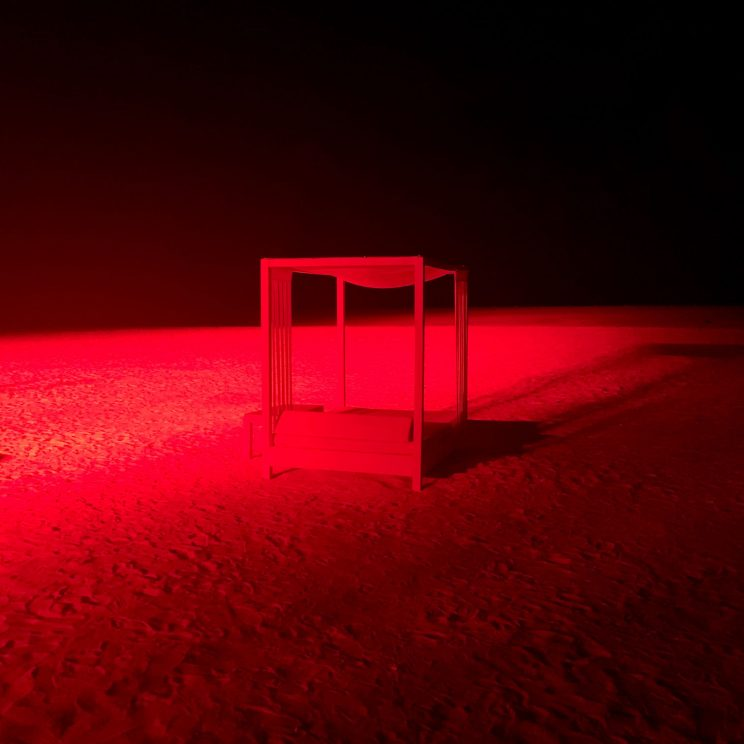 Beach at night lit in red