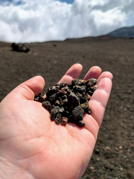 Alex holding some rubble from near Piton de la Fournaise