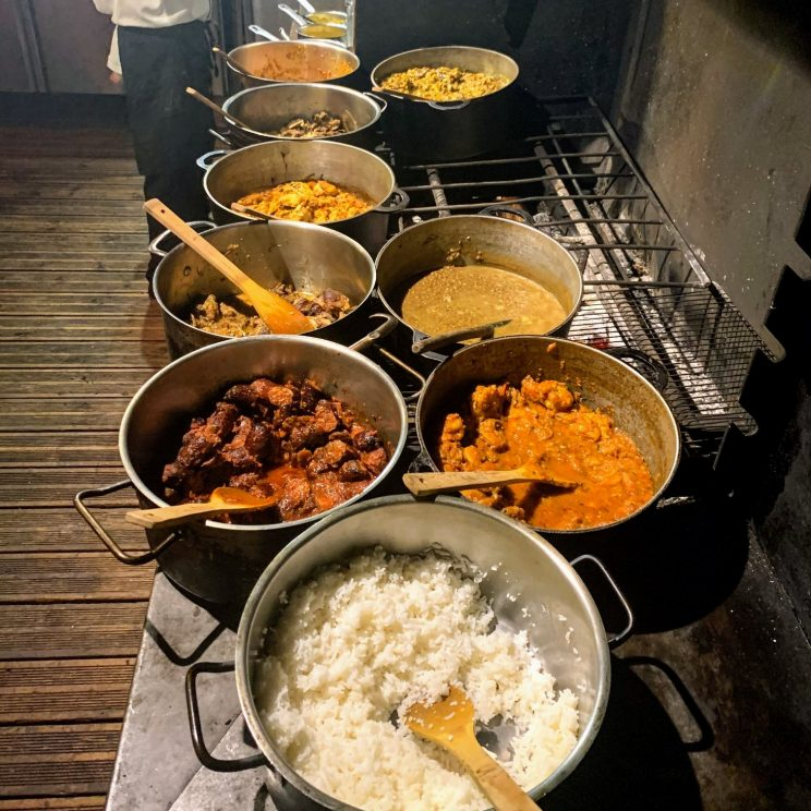 Pots of creole food being kept warm