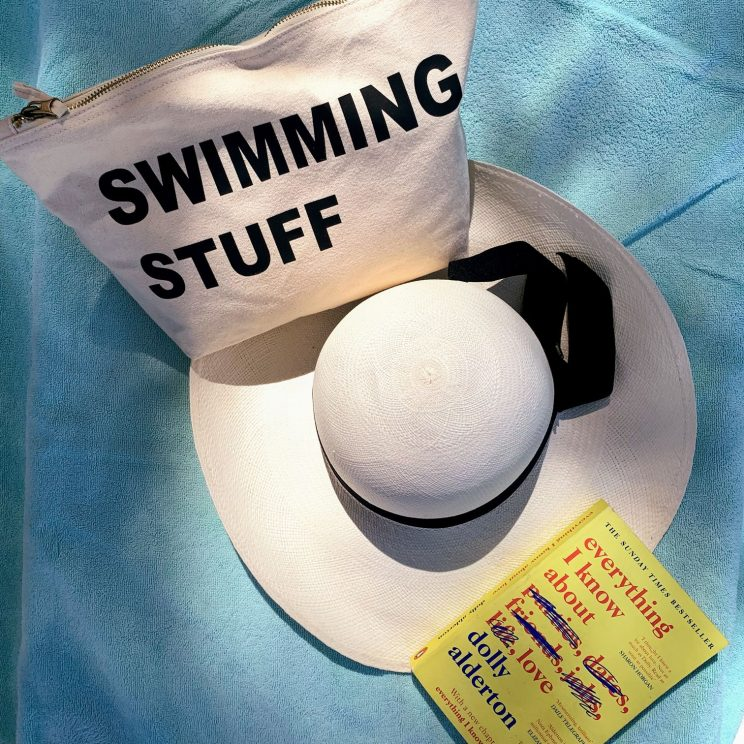 "Alex's ""swimming stuff"" bag, hat and book"