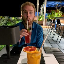 Me sipping a cocktail