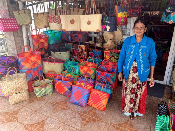 The bag maker posing with her bags