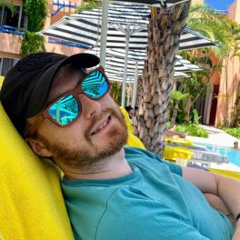 Me reclining while wearing my sunglasses