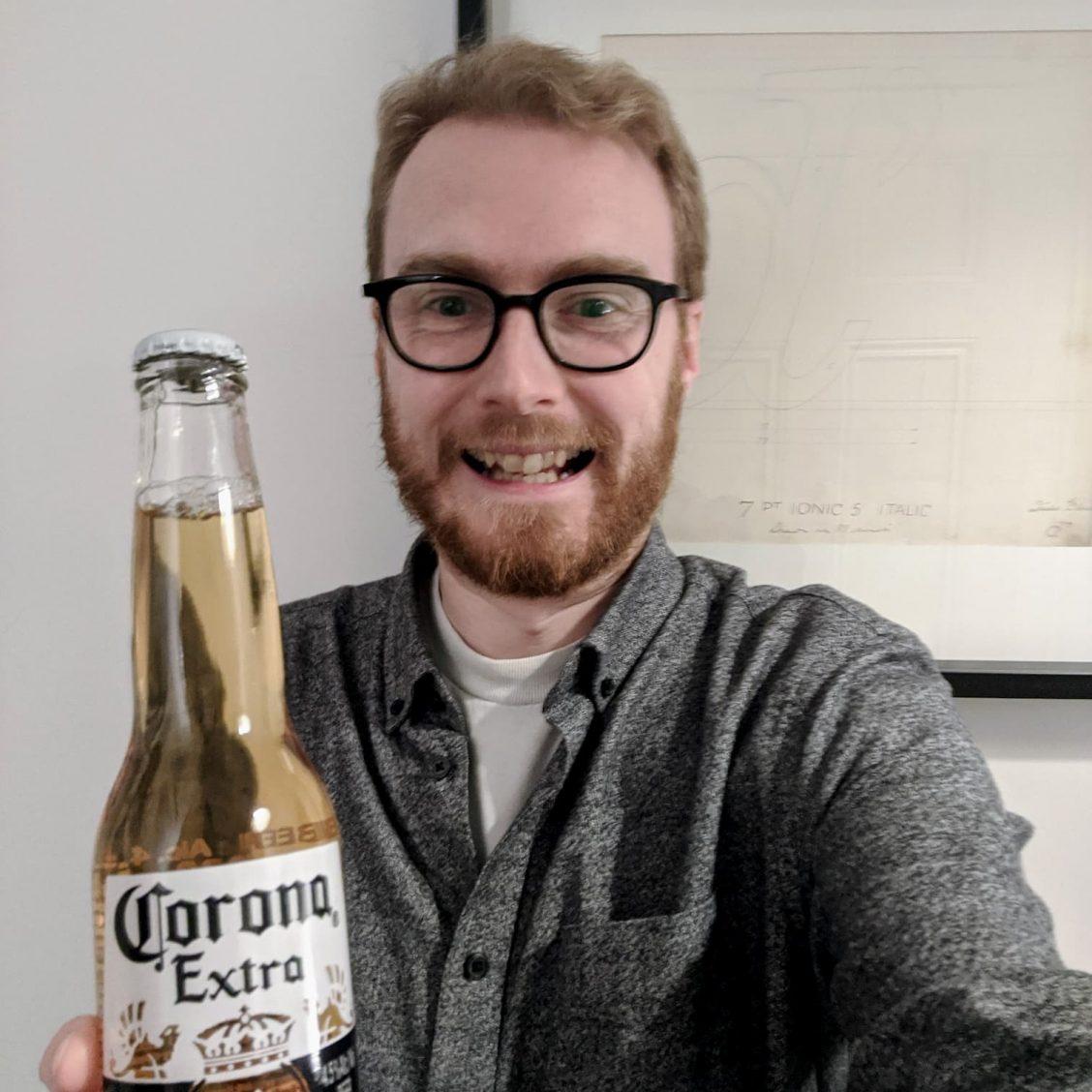 Me holding a bottle of Corona